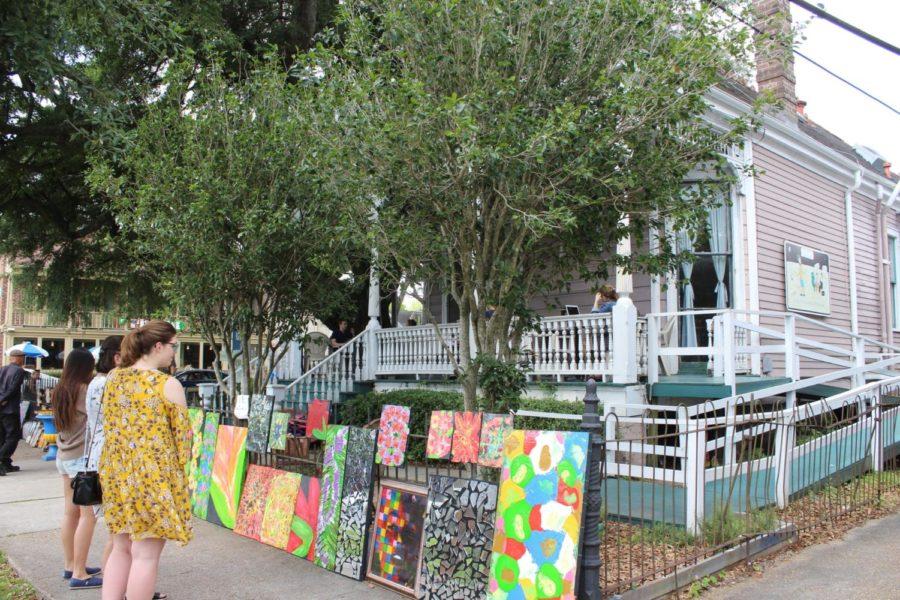 People admire the art on display outside Café Luna.