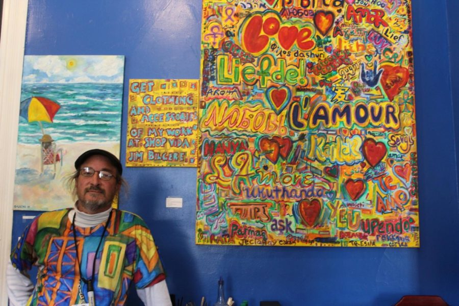 Artist+Jim+Bilgere+poses+in+front+of+his+paintings+which+are+displayed+on+the+walls+of+Caf%C3%A9+Luna.+Photo+credit%3A+Catie+Sanders
