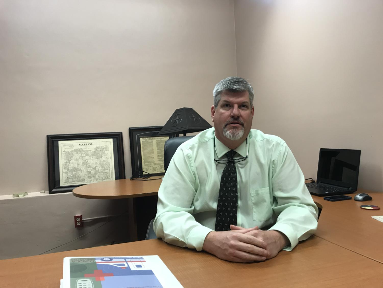 Director of Loyola University Police Department Todd Warren settles in to his new office. Warren brings 25 years of law enforcement experience. Photo credit: Andrew Lang