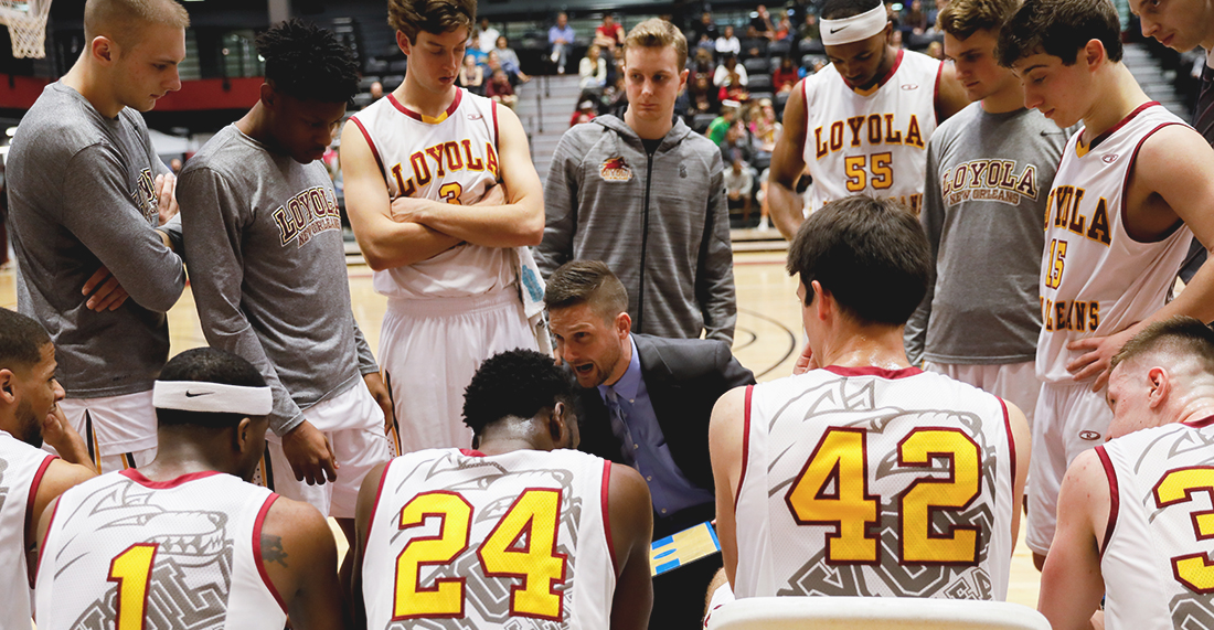 Head coach, Stacy Hollowell, talks strategy to Loyola's Men's Basketball team during the Jan. 20, 2018, game against Faulkner University. Loyola won the game by 12 points. JULIA SANTOS/The Maroon.