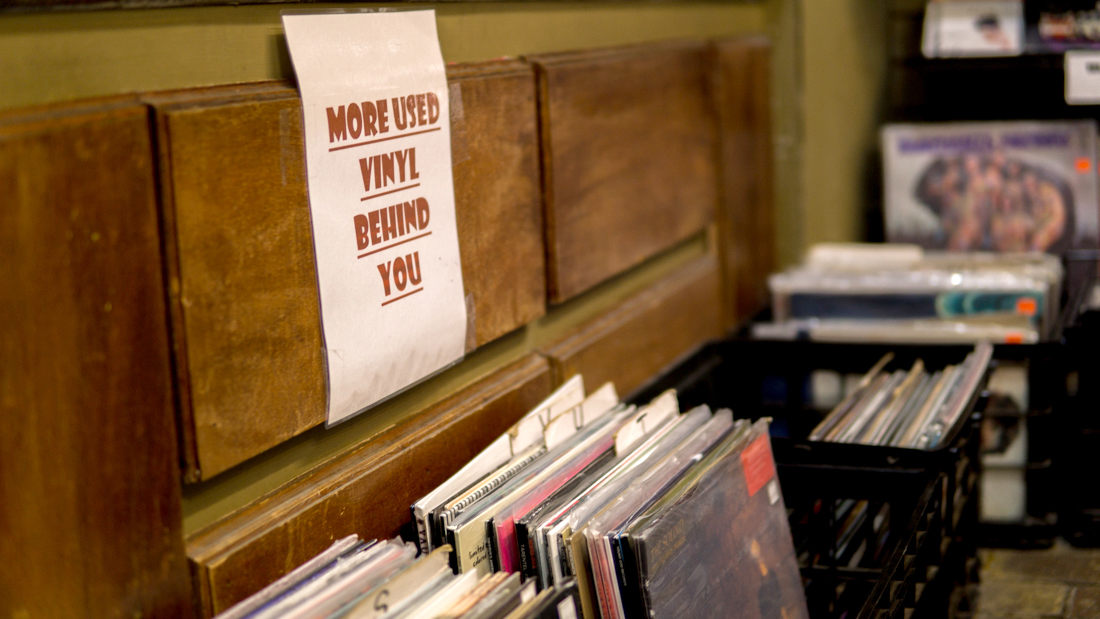 In case anyone meandering into Skully'z overlooks the floors littered with re-purposed milk crates holding vinyl sleeves, this sign stands as a reminder to those who might look for a bargain on second-hand records. Photo credit: Jacob Meyer