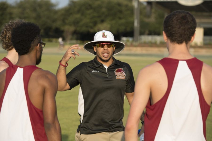 Nick Dodson coaching Loyola track runners at a competition. Dodson will leave Loyola for the head coach position at Southeastern University in Lakeland, Florida after coaching the Wolf Pack for the past two years. Photo credit: Loyola University Athletics