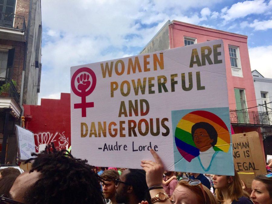 A protester holds up a sign at the New Orleans Women's March in January 2017. Courtesy / Camille Didelot