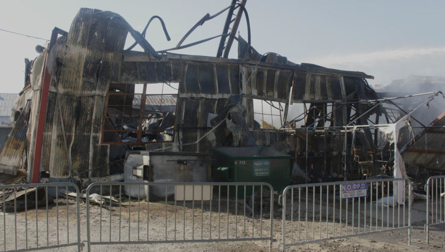 The+warehouse+holding+Canal+Furniture+Liquidators+and+NOLA+Til+Ya+Die%2C+pictured+here+on+April+24%2C+stands+damaged+after+being+engulfed+in+flames+Monday+morning.++The+cause+of+the+fire+has+yet+to+be+discovered+and+is+under+an+ongoing+investigation.+Photo+credit%3A+Caleb+Beck