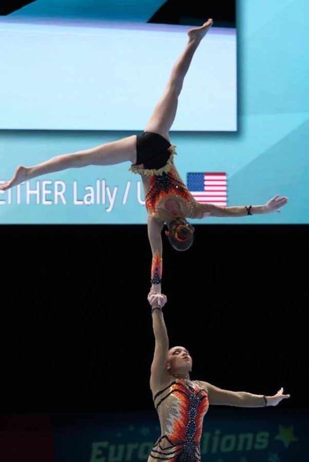 Political+science+freshman+Sam+Conway+holding+her+partner+Lally+Seither+in+the+air.+Conway+has+chosen+to+leave+active+competition.+Eric+Chang%2FCourtesy.