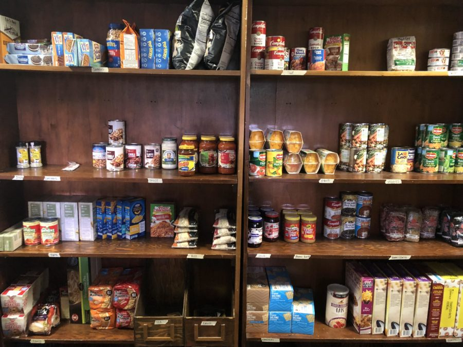 Non-parishables lines the shelves of the new food pantry created by the Loyola Music Therapy Student Association and the Sigma Alpha Iota music fraternity. The pantry opened on Monday, April 30, 2018. Photo credit: Sidney Holmes