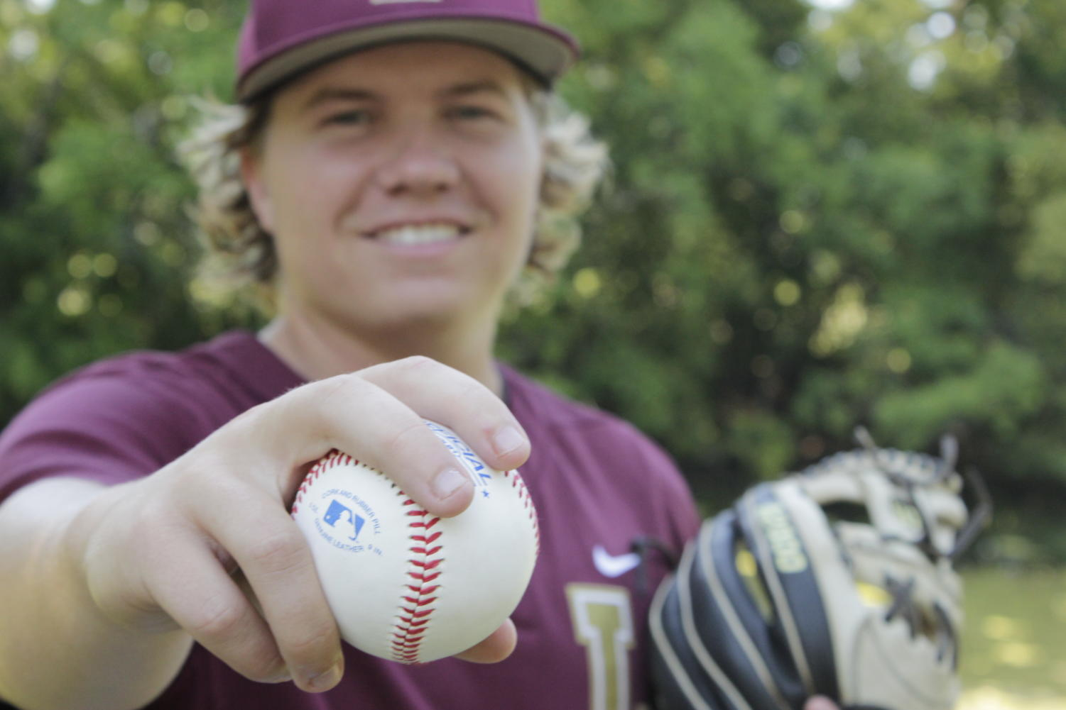 Joseph Kulcher, marketing senior, reflects on his last moments in a maroon and gold uniform. Kulcher leaves Loyola after four years spent on the team and a career in marketing in his future after college. Photo credit: Jules Lydon