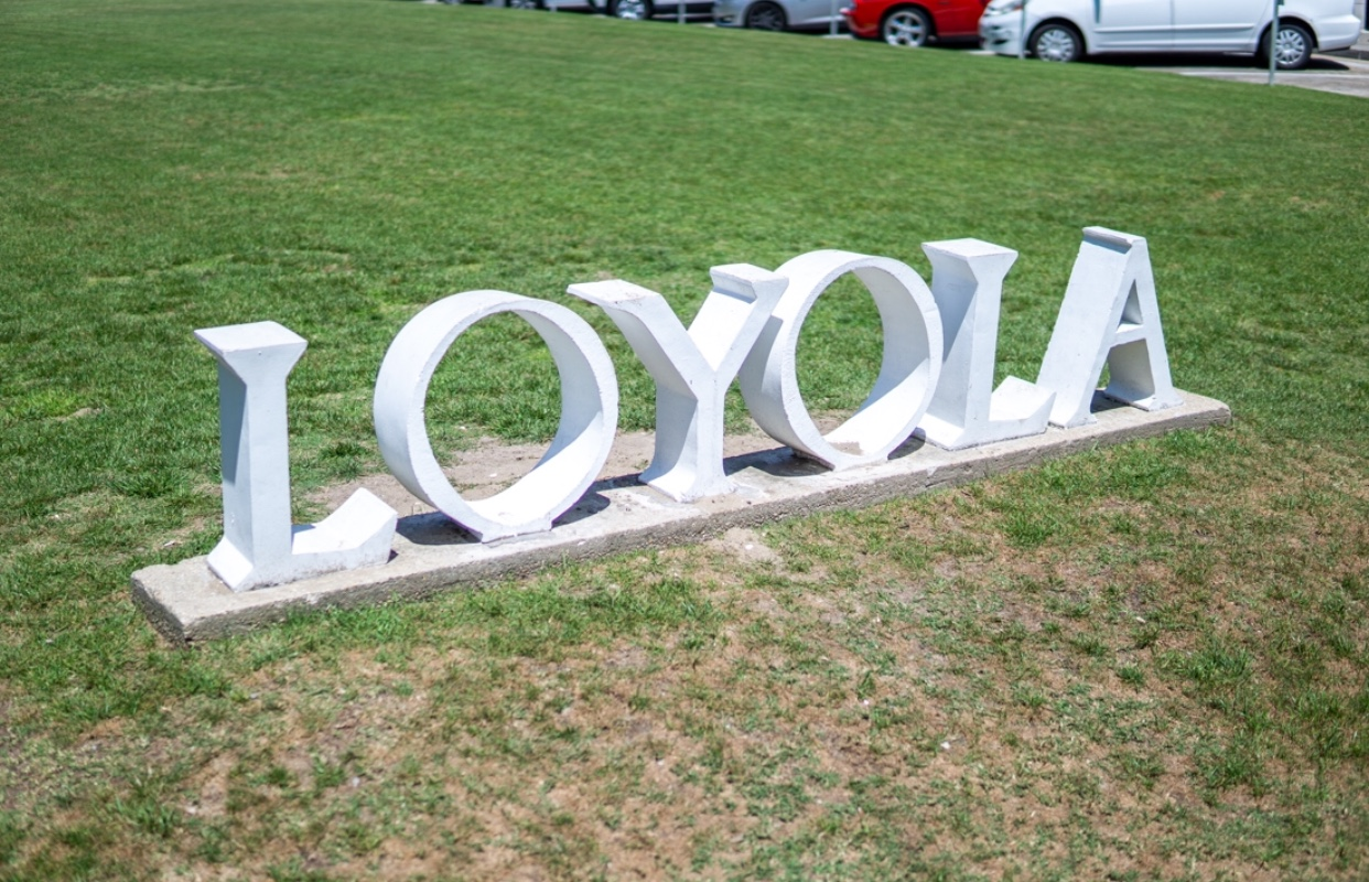 The Loyola sign outside of Marquette Hall on st. Charles. Photo credit: Jacob Meyer