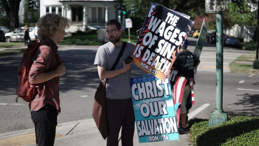 A+Loyola+student+confronts+a+Westboro+Baptist+Church+member+on+June+28%2C+2018.+Photo+credit%3A+Jacob+Meyer