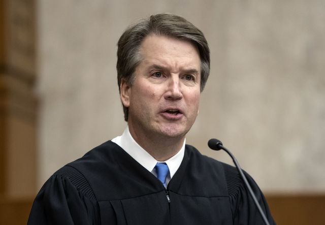 In this Aug. 7, 2018, photo, President Donald Trumps Supreme Court nominee, Judge Brett Kavanaugh, officiates at the swearing-in of Judge Britt Grant to take a seat on the U.S. Court of Appeals for the Eleventh Circuit at the U.S. District Courthouse in Washington. Kavanaugh has expressed concern about federal agencies running amok. But his view that they should adhere strictly to laws passed by Congress worries liberals.  (AP Photo/J. Scott Applewhite)