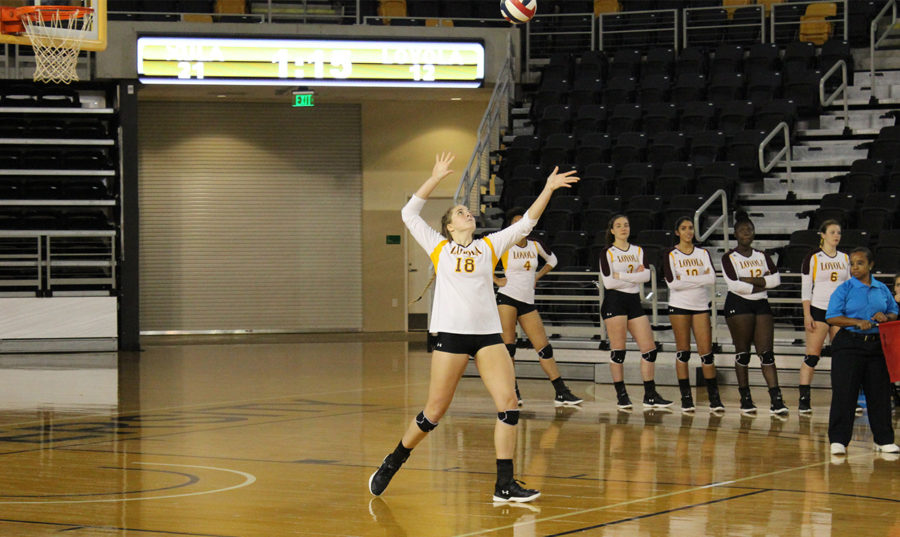 Psychology+senior+Malea+Howie+goes+to+serve+the+ball.+Howie+finished+with+one+service+ace+against+Middle+Georgia+State+University.+Photo+credit%3A+Loyola+New+Orleans+Athletics