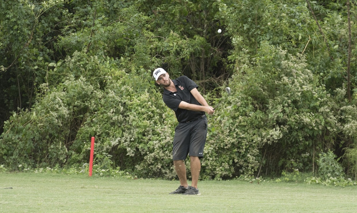 Mass communication senior Ryan Hicks takes a shot from the fairway. Hicks finished +4 in the two days of competition at the Savannah College of Arts and Design Atlanta Fall Invitational. Photo credit: Loyola New Orleans Athletics