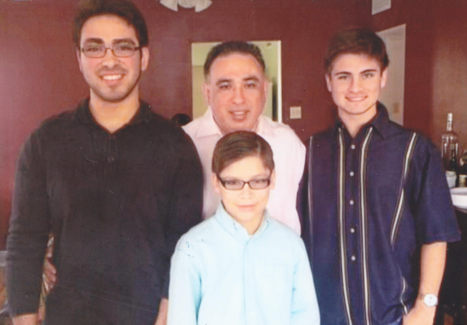 Andres Fuentes (left), Alejandro Fuentes (bottom center), Armando Fuentes (right) and Cesar Fuentes (middle) enjoying quality family moments Thanksgiving, 2014. Fuentes is proud to be Hispanic. Courtesy of Andres Fuentes. Photo credit: Andres Fuentes
