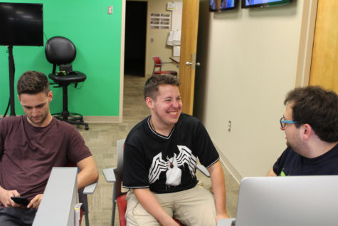 Cody Downey, mass communication junior and copy editor for The Maroon, laughing with his fellow copy editor, Riley Katz. Cody writes about his experiences growing up with two cultures. Photo credit: Andres Fuentes