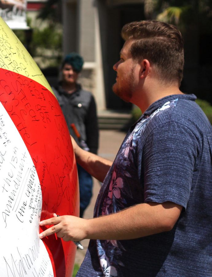 The organization of Young Americans for Liberty had a free speech ball in the Peace Quad. Marcus Maldonado, Tulane student, wanted to promote free speech.  Photo credit: Cristian Orellana