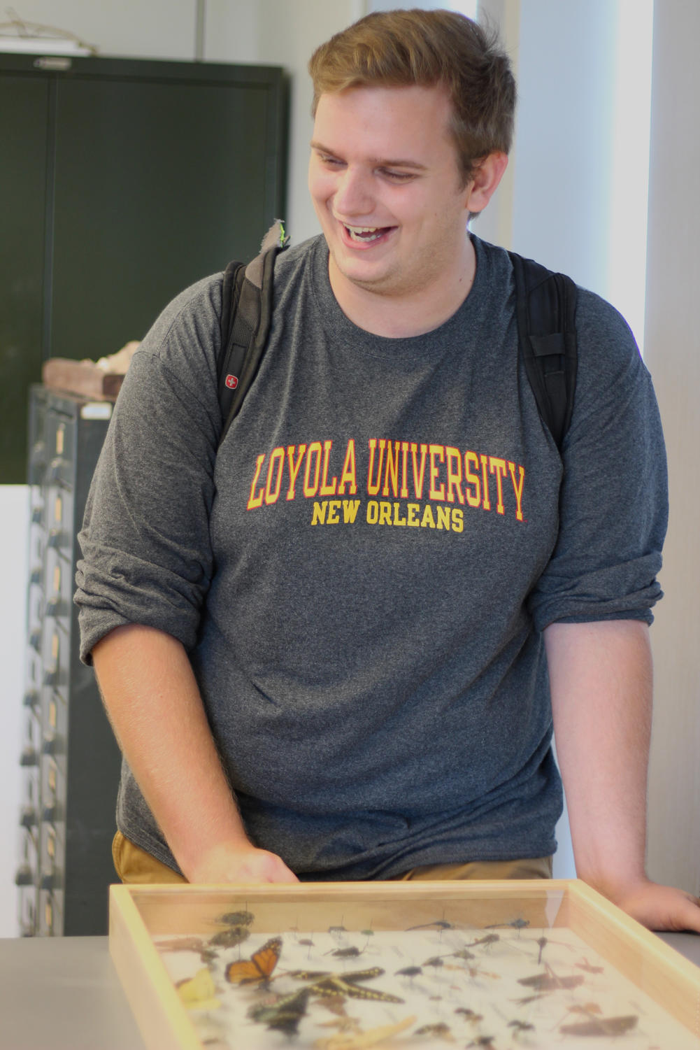 A cheerful Andrew Harper, environmental science senior, smiles as he describes his upcoming talk. Harper's thesis was driven by his interest in the interactions between dragonflies and an urban environment. Photo credit: Cristian Orellana