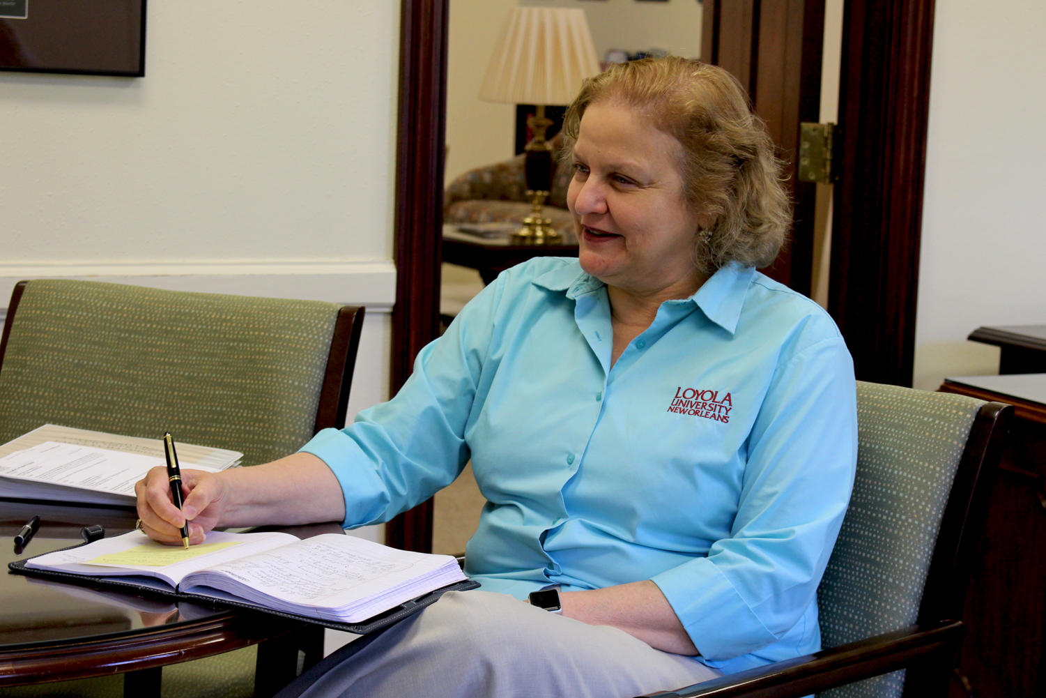 Interim provost Maria Calzada in her office in a meeting on September 5. Calzada wishes to bring awareness to Hispanic Heritage Month on Loyola's campus. Photo credit: Alexis Reyes