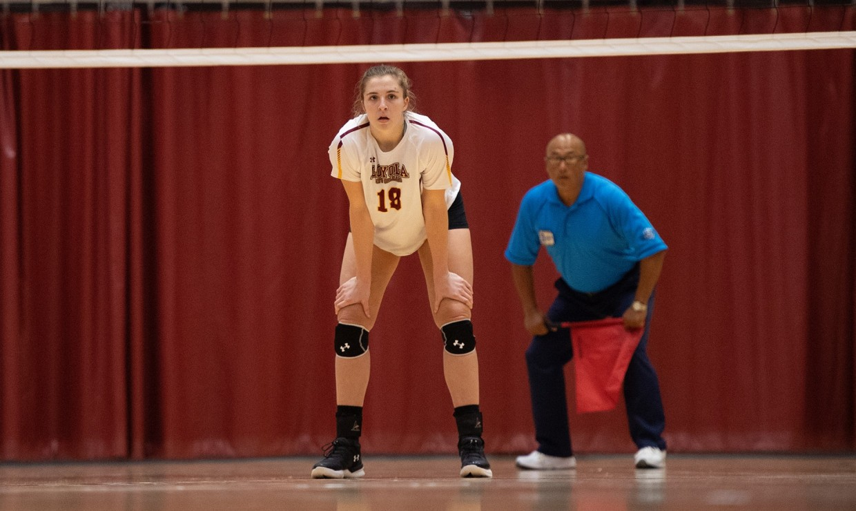 Psychology senior Malea Howie stands out the ready. Howie finished with 22 kills in the two games against Florida College and Florida National University. Photo credit: Loyola New Orleans Athletics