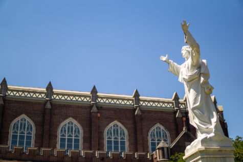 Statue of Jesus stands in front of Marquette Hall on St. Charles Ave. Photo credit: Jacob Meyer