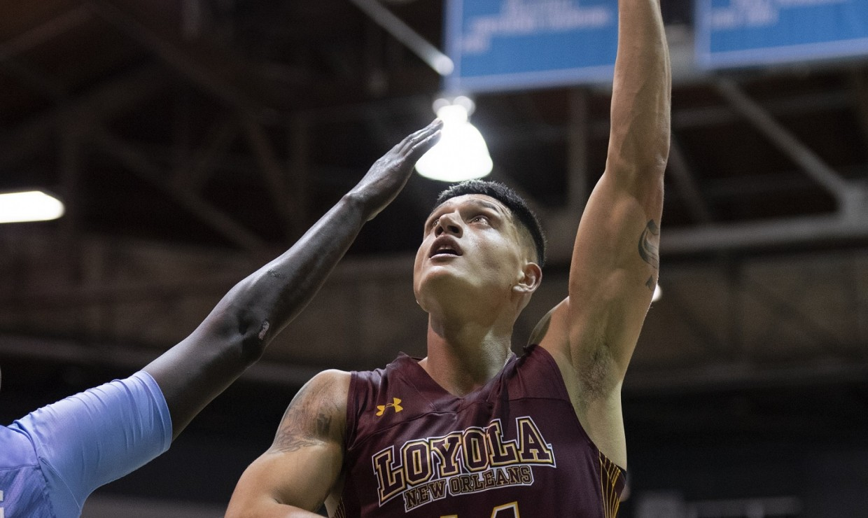 Business senior Sammis Reyes puts up a shot. Reyes led the team with 8 rebounds and 6 assists against Xavier University. Photo credit: Loyola New Orleans Athletics