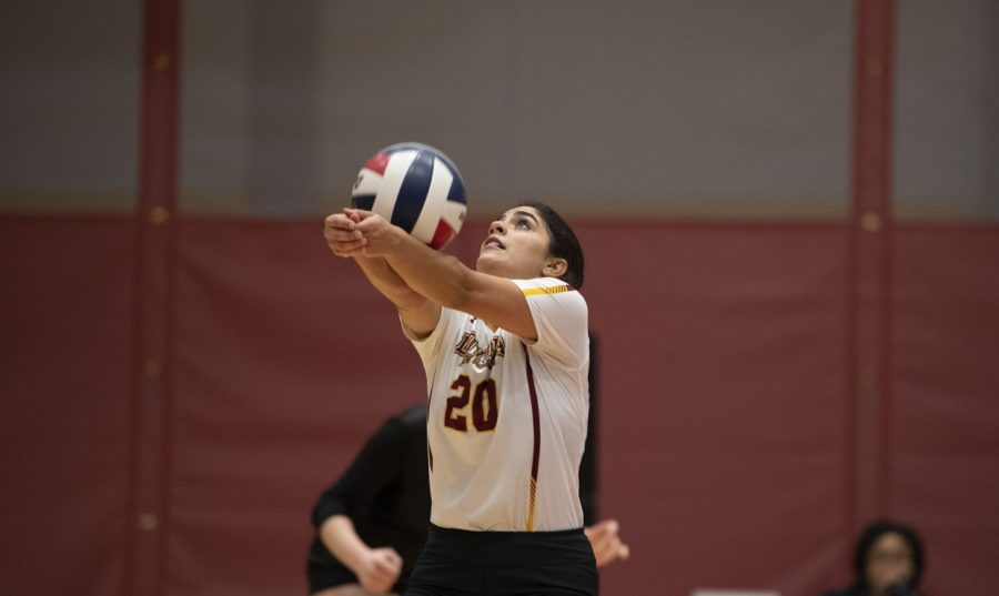 Psychology pre-med sophomore Helene Masone bumps the ball. Masone finished with nine digs in the final game against Faulkner. Photo credit: Loyola New Orleans Athletics