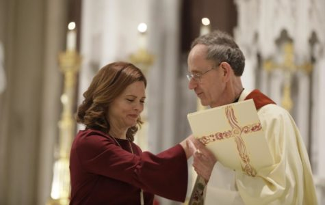President Tania Tetlow is blessed by her uncle, the Rev. Joseph Tetlow, at the Missioning Mass on Nov. 15 2018. Photo credit: Cristian Orellana