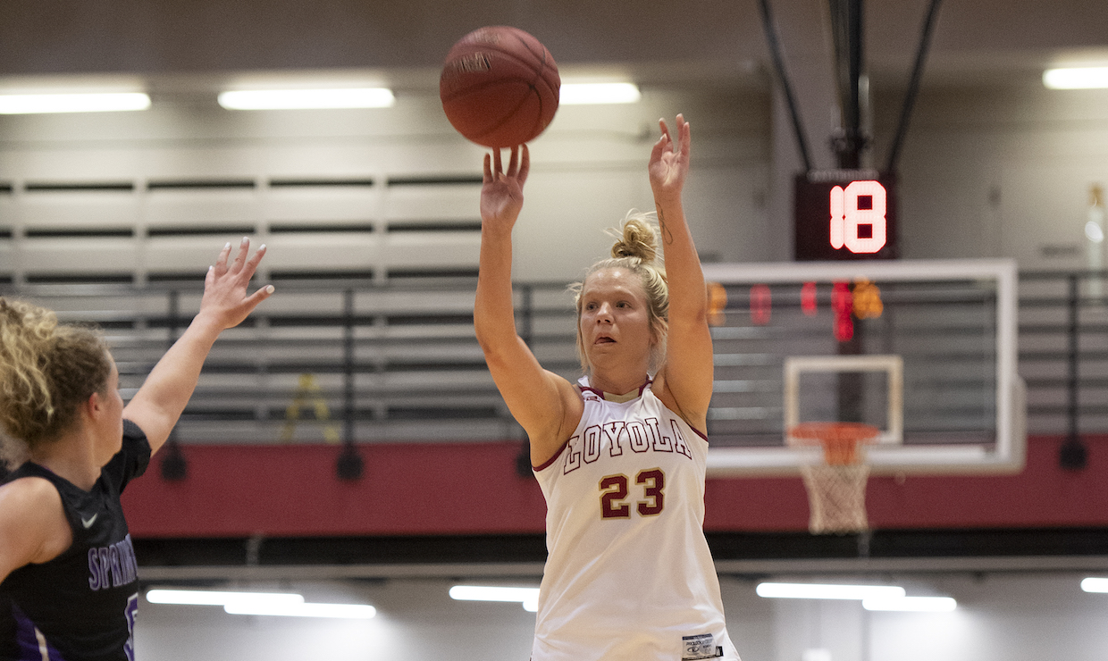 Psychology and Pre-Health senior Megan Worry throws up a shot. Worry finished with nine points against Northwestern State University.