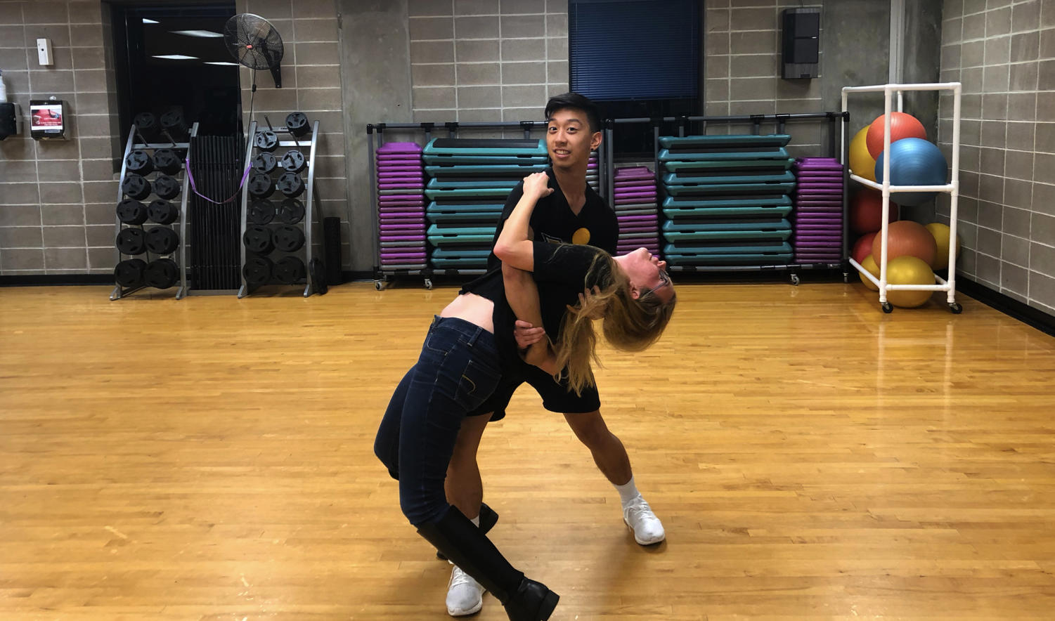 A Loyola student endangers her health by trusting sports reporter JC Canicosa to not drop her. Canicosa showed off his moves or lack thereof by trying out Loyola's Swing Dance Club. Photo credit: Will Ingram