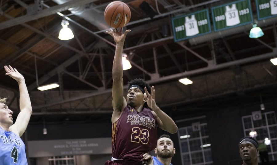 Mass communication Zach Wrightsil nearly records a triple-double with 27 points, 14 rebounds and nine assists. Photo credit: Loyola New Orleans Athletics