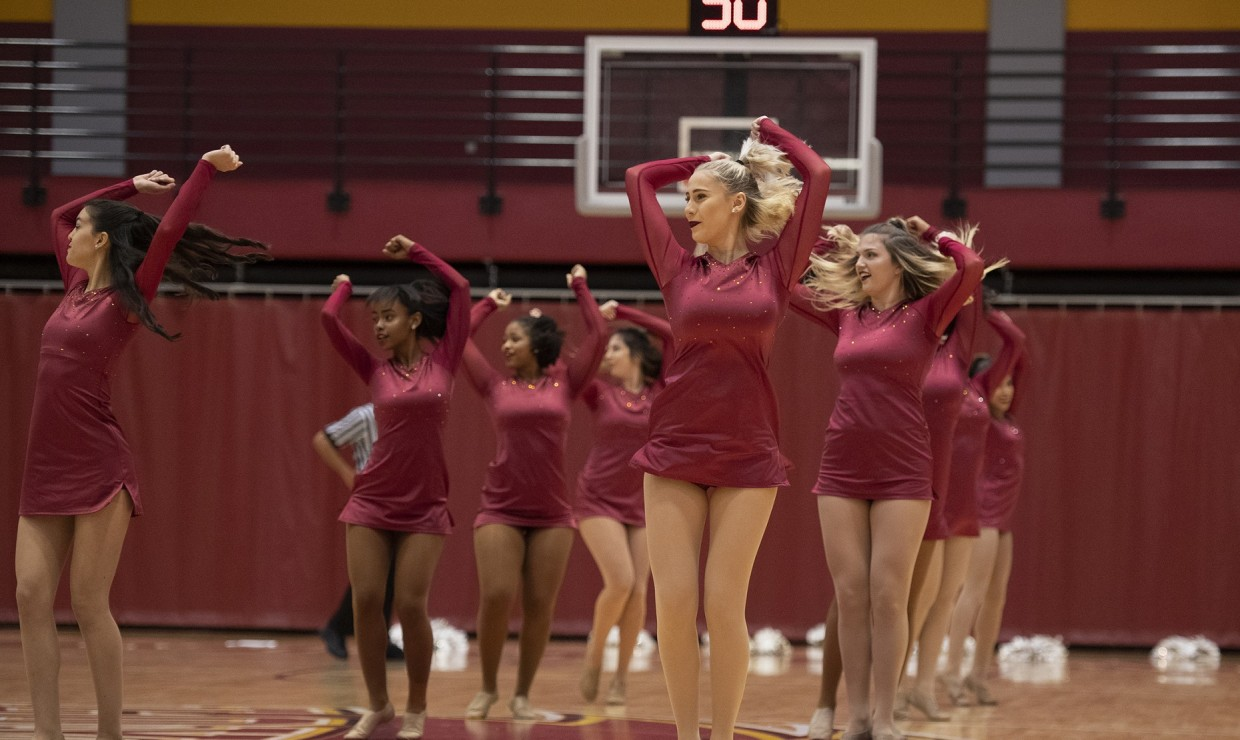 Loyola's competitive dance team doing a holiday halftime routine during Photo credit: Loyola New Orleans Athletics