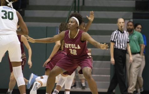 Biology freshmen Tera Snell guards the ball-handler against Tulane University Oct. 30. The Wolf Pack lost the matchup against Brewton-Parker College on Dec. 1. Photo Credit: Loyola New Orleans Athletics