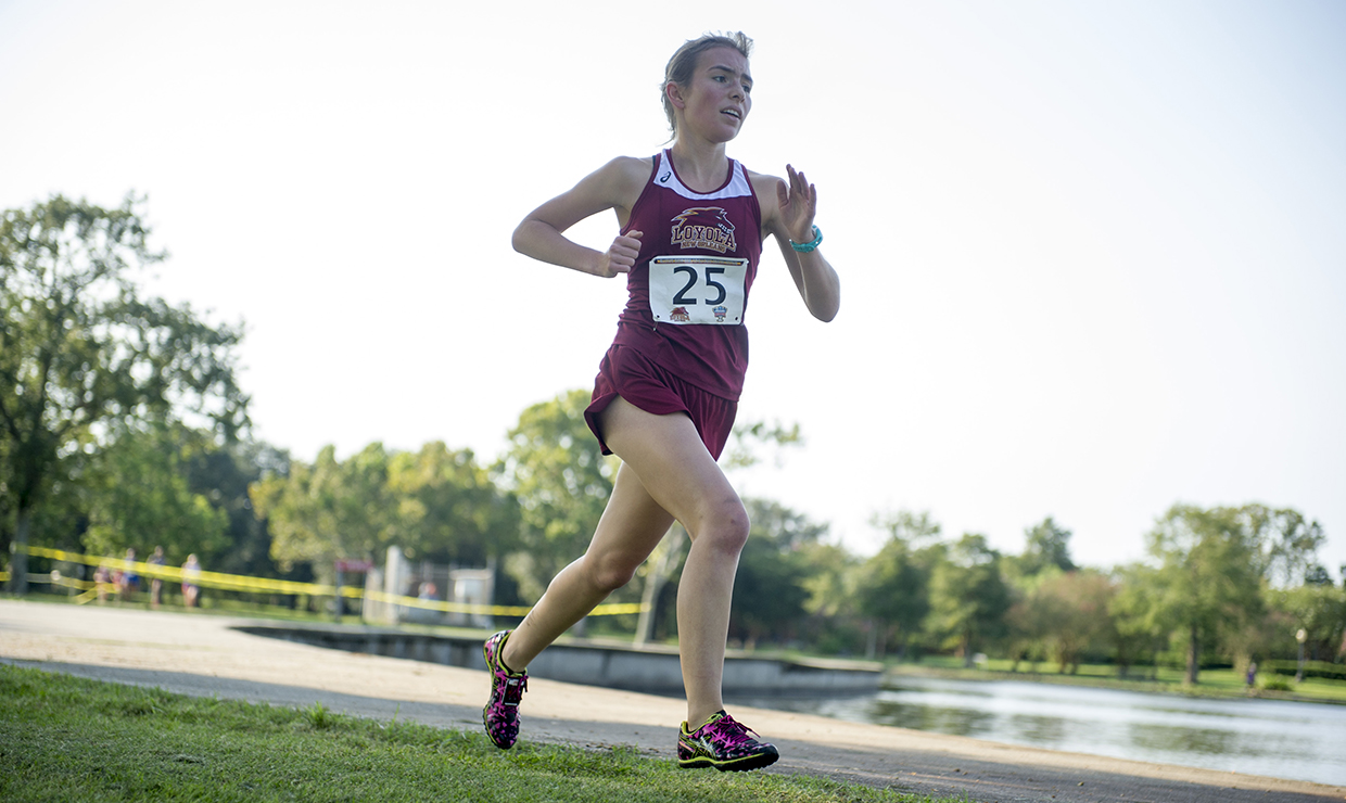 Sasha Solano-McDaniel, sociology sophomore, sprinting in a cross country race. Photo credit: Loyola New Orleans Athletics