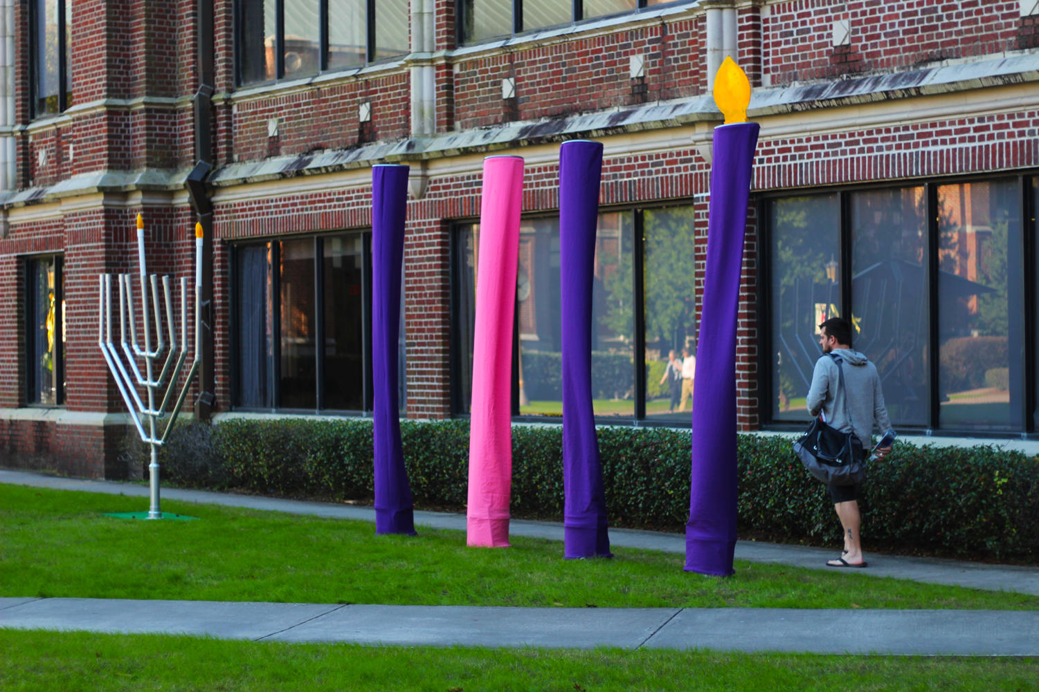 A menorah and Advent candles stand outside Bobet Hall in the Peace Quad. Photo credit: Cristian Orellana