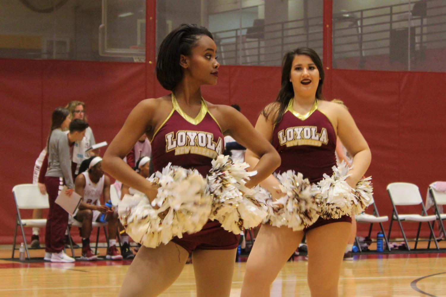Cereyna Bougouneau, theater arts junior, performing during a halftime show during a women's basketball game at The Den Feb. 8 2018. Bougouneau brings her Caribbean ties to Loyola's competitive dance team. Photo credit: Andres Fuentes