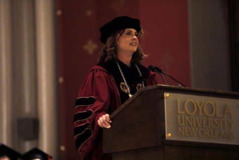 Tania Tetlow takes the podium at her presidential inauguration. Photo credit: Angelo Imbraguglio