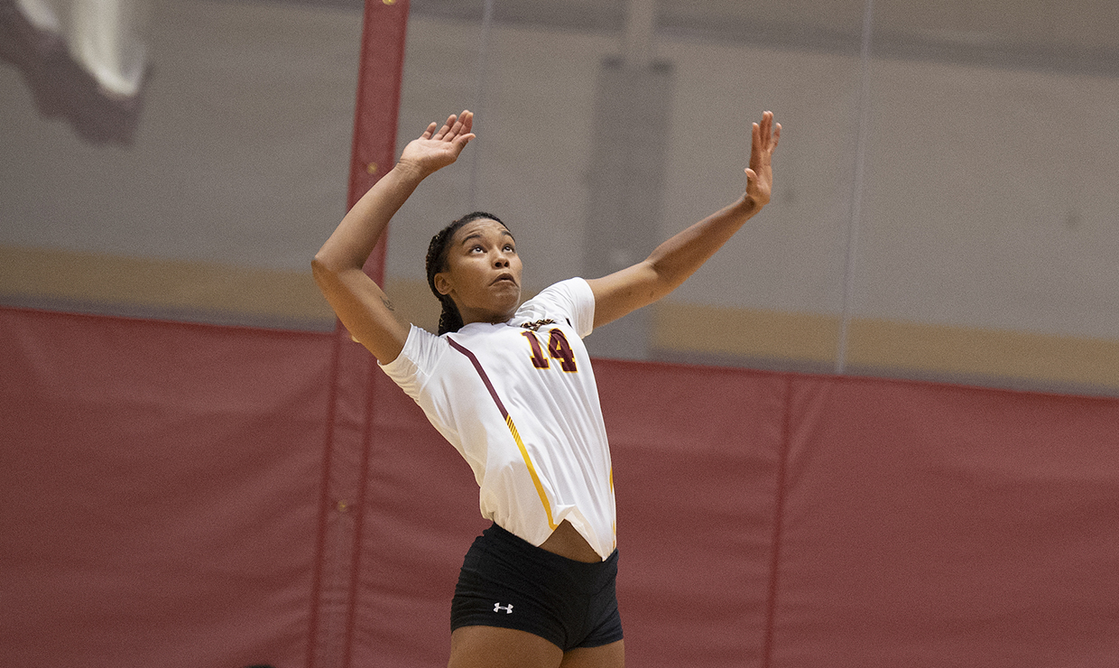 Mass communication junior Tylar Beckham reached for the volleyball in a match at The Den on Sep. 25 2018. Photo credit: Loyola New Orleans Athletics