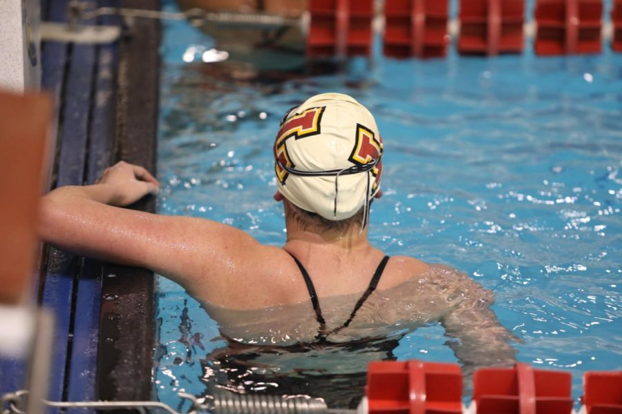 A+Loyola+women%27s+swimmer+looks+at+her+total+time+after+her+relay+race.+Photo+credit%3A+Andres+Fuentes