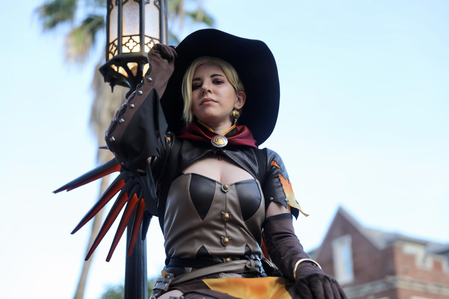 Kris D'Arcangelo dresses up as Mercy from the video game, Overwatch. D'Arcangelo says she finds a welcoming community within cosplayers. Photo credit: Andres Fuentes