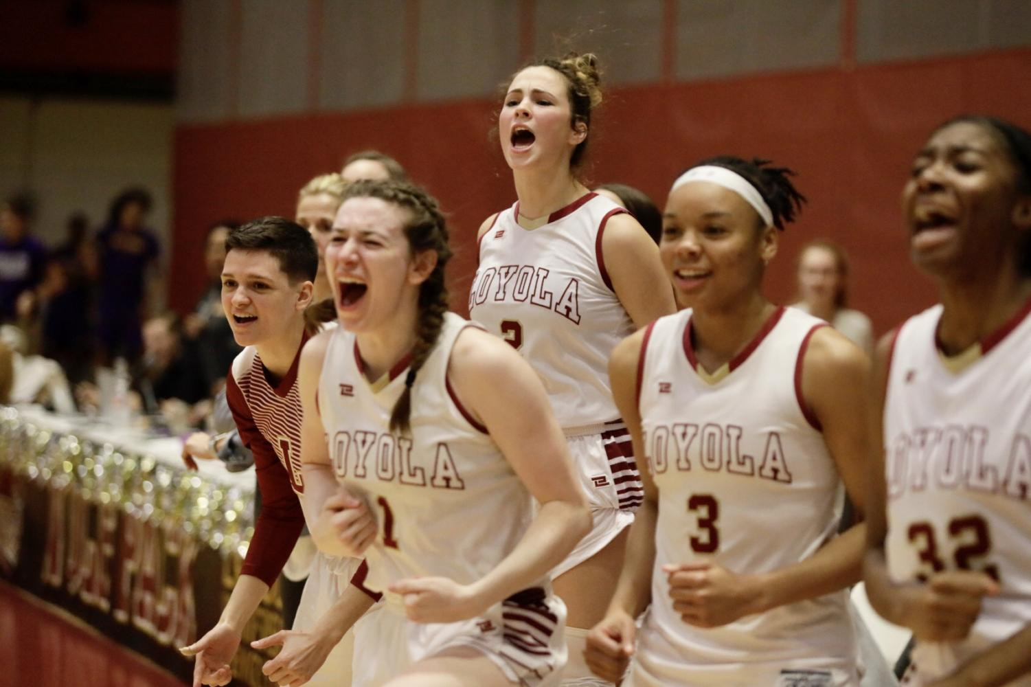 Loyola's women's basketball team celebrates a play versus Bethel University in The Den on Feb. 14. The women's team ended the regular season as the No. 2 seed in the conference. Photo credit: Andres Fuentes