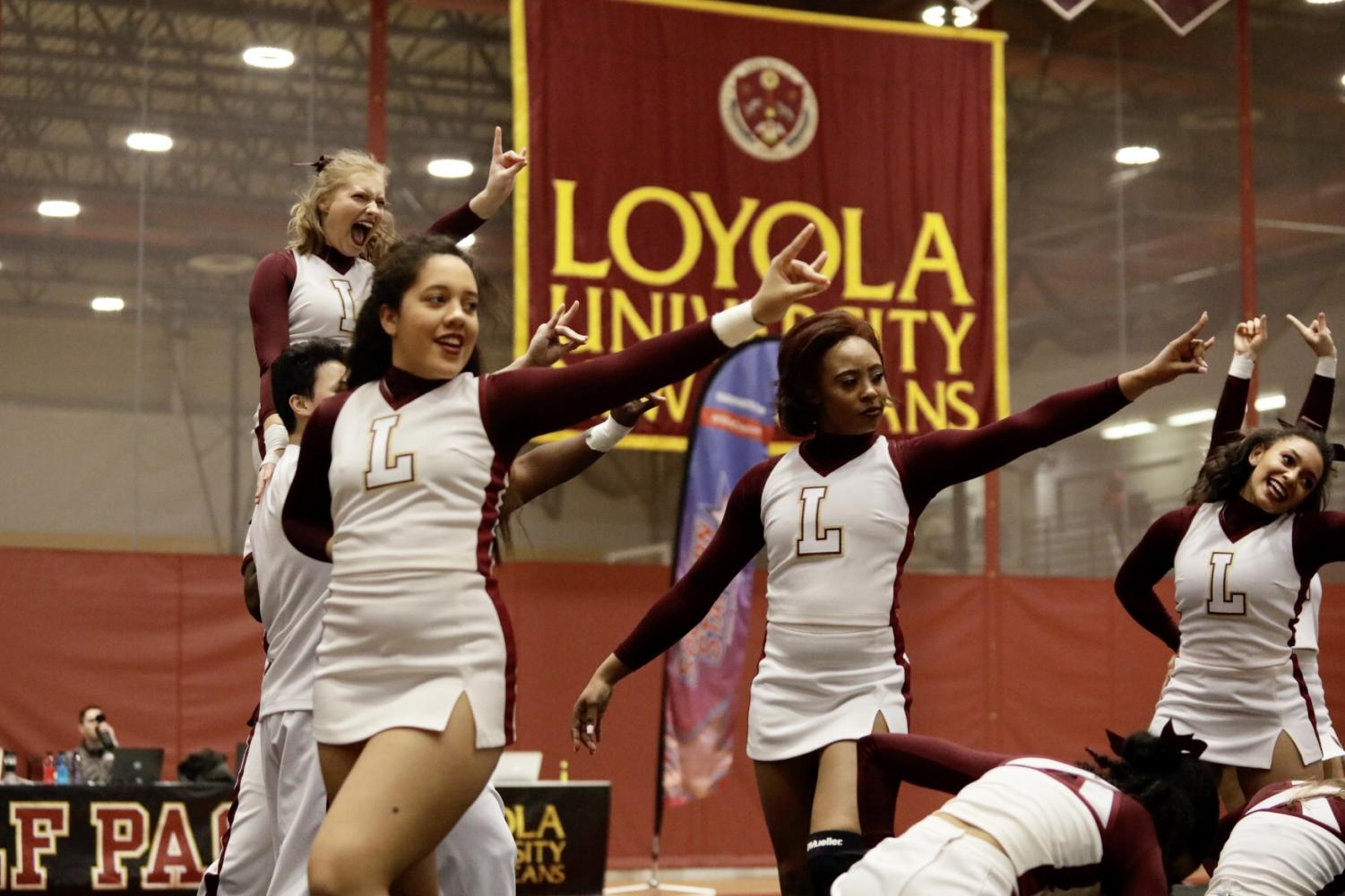 Loyola's cheer team performs their routine at the Southern States Athletics Conference Championship in The Den. The cheer team placed third at the regional meet and the dance team placed fourth. Photo credit: Ariel Landry