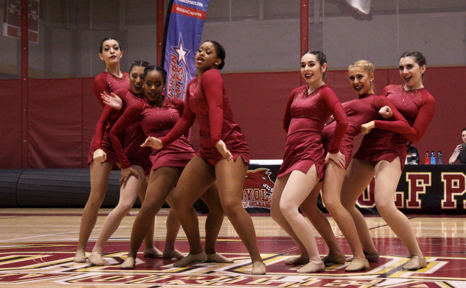 Loyola's dance team strikes a pose during their routine during the conference championship. Photo credit: Ariel Landry