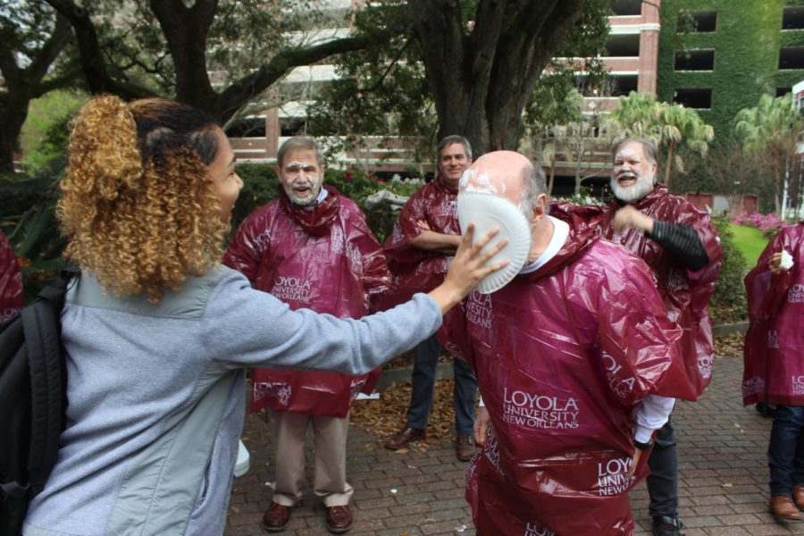 Walter Block, economics professor, recieves a plate of shaving cream to the face on Feb. 26. The pieing was part of a University Honors Association event that asked students to donate $1 to the Gulf Restoration Network in exchange for pieing a participating professor.