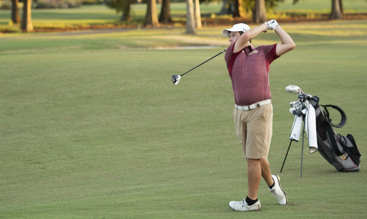 Business senior Philip Nijoka tees off at Audubon Park. Nijoka finished in third place at the Badger Invitational. Photo credit: Loyola New Orleans Athletics