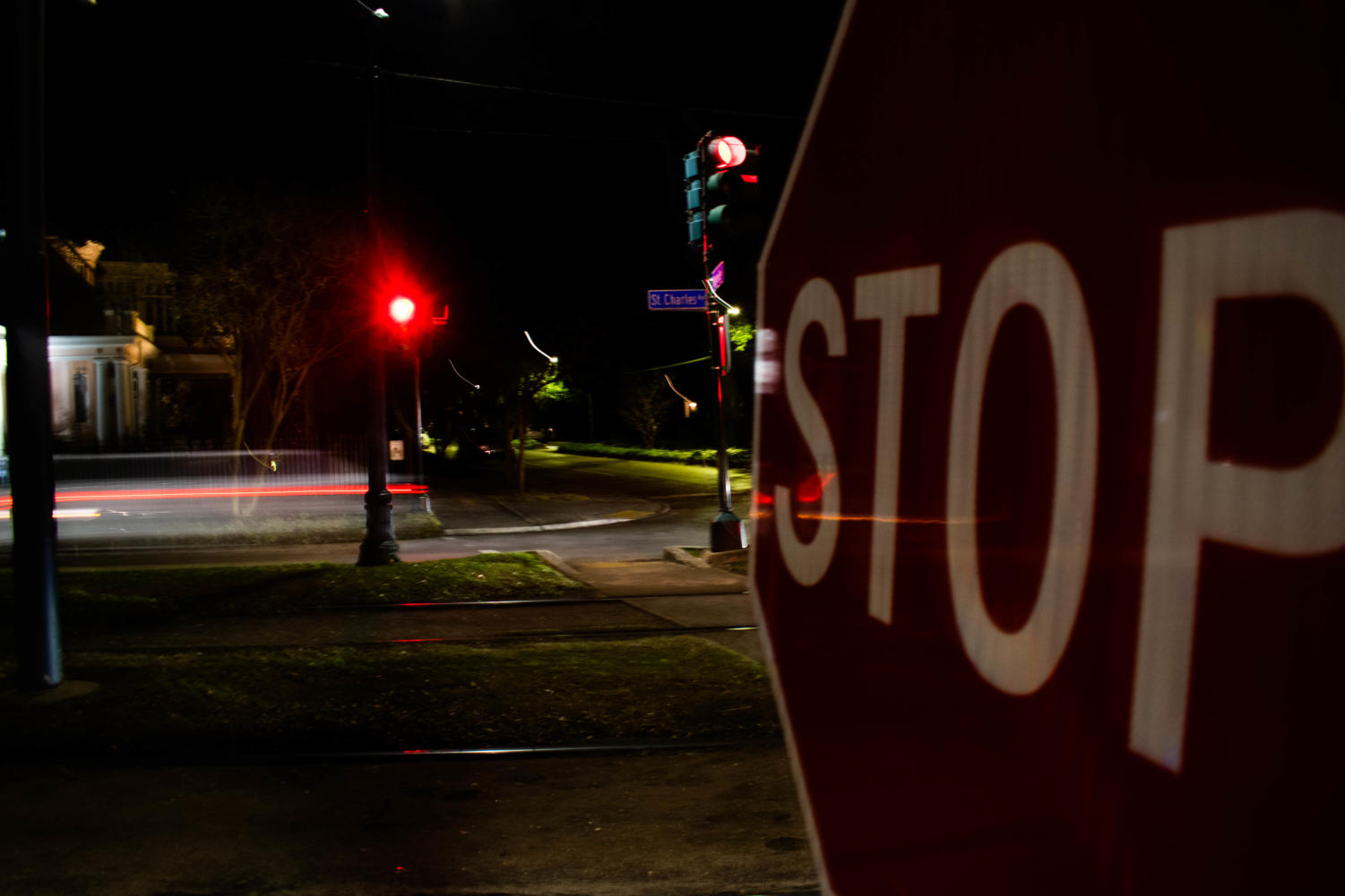 The stop sign placed at the crossroad of Nashville Avenue and St. Charles Avenue. The malfunctioning light has turned the streetlight to a four-way stop sign. Photo credit: Michael Bauer