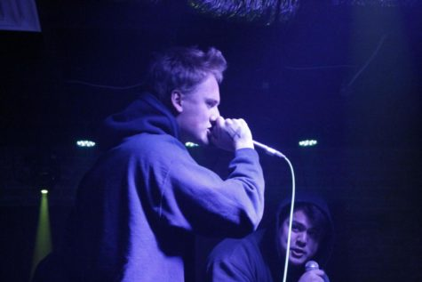 Max Taylor and Niccolo Short, two Loyola rappers, collaborate onstage.