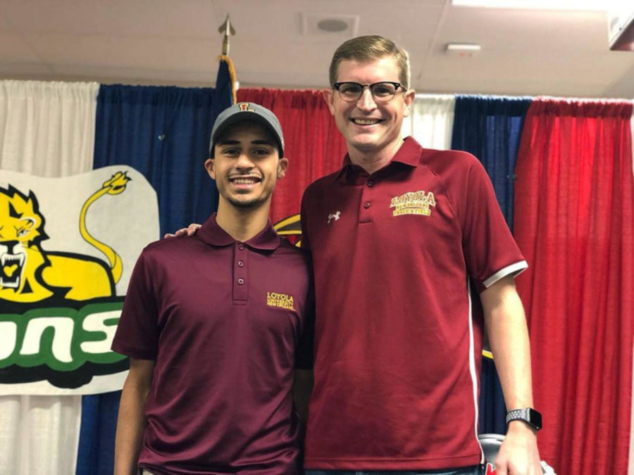 Abdel Thabata (left) poses with Loyola track and field head coach Kevin Licht at John Ehret High School for Signing Day on Dec. 19 2018. Courtesy of Abdel Thabata.