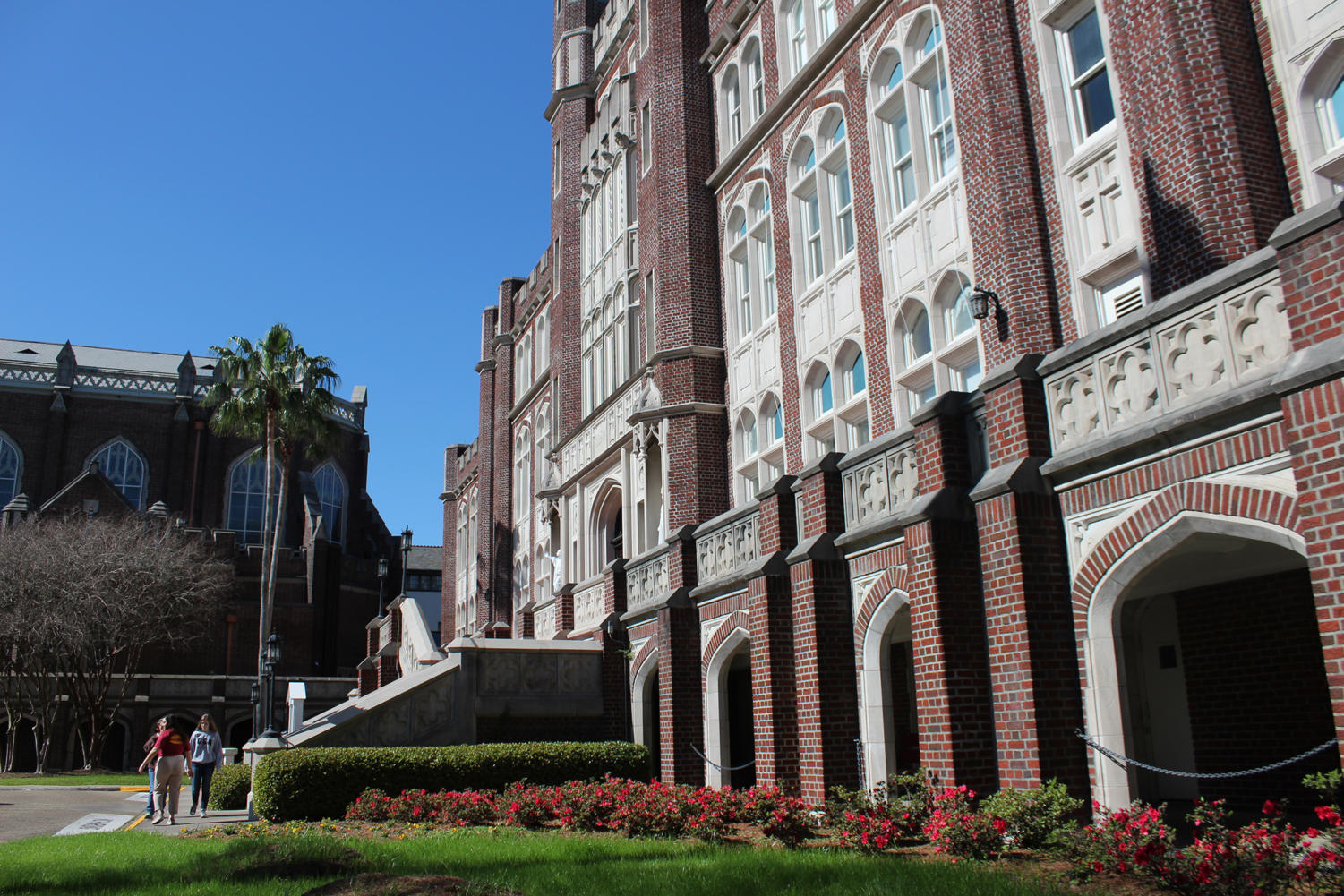 Students walk in front of Marquette Hall. Loyola is evaluating all buildings on campus. Photo credit: Cristian Orellana