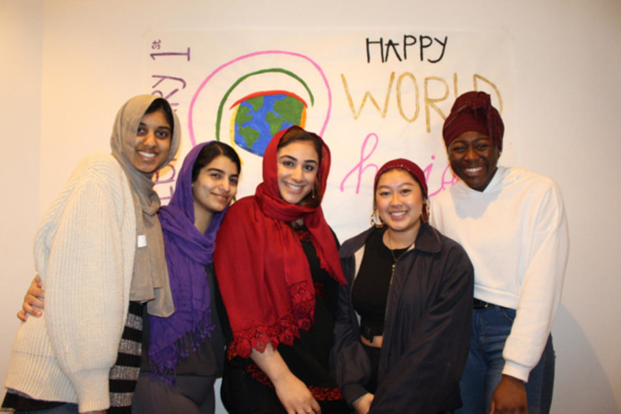 A+group+of+Loyola+students+tries+on+hijabs+during+the+Muslim+Students+Association%E2%80%99s+celebration+of+World+Hijab+day+on+Feb.+1.++The+organization+hosted+the+event+in+order+to+combat+stereotypes+about+people+who+wear+hijabs.+Photo+credit%3A+Ruba+Esmail