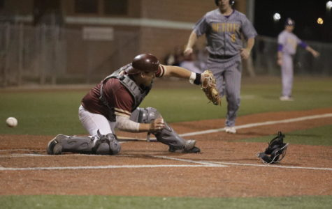 Biology sophomore Gabriel Trastoy misses a throw to home plate, causing Bethel to score in Game 2. Loyola would drop three straight games to the Wildcats. Photo credit: Andres Fuentes