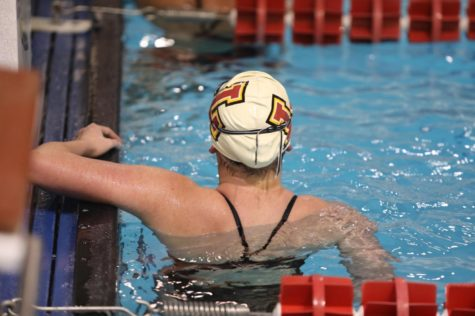 A Loyola women's swimmer looks at her total time after her relay race at a home meet on Jan. 9, 2019. Loyola's swim teams had top-10 finishes for the second year in a row. Photo credit: Andres Fuentes